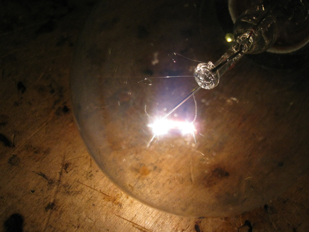 High voltage arc in a broken lightbulb